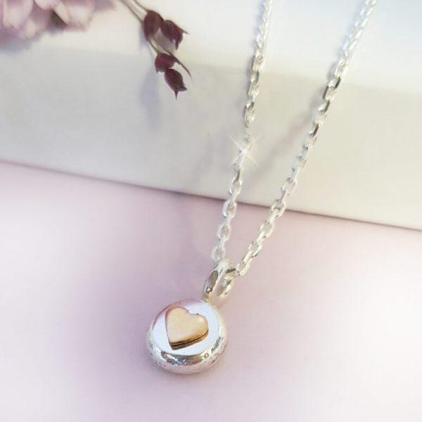 RAW silversmycke med guldhjärta